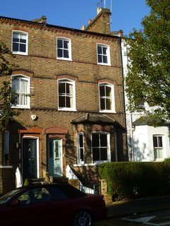 Before: The mid-terrace Victorian house in London's Brook Green neighborhood had three floors above ground and a ground-level basement kitchen that accessed the rear garden.