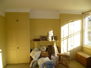 Before: In a bedroom, the detailing on the cupboards and fireplace skewed traditional.