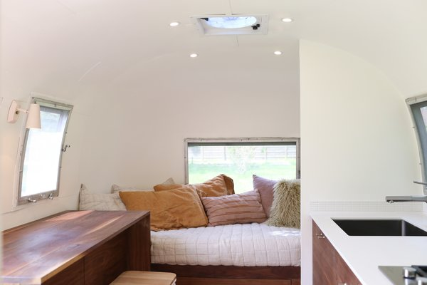 The custom-sized bed has an organic mattress from The Mattress Insider that was cut to the Airstream's curved walls.