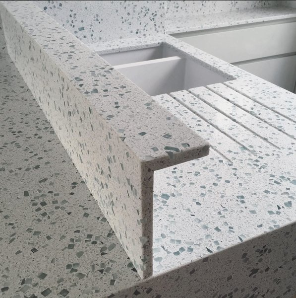 """""""The worktops are made by a British company called Resilica,"""" says Baulier. """"They use glass waste (old windscreens, windows, and bottles) to create beautiful and incredibly durable countertops. Unlike terrazzo, it doesn't stain, as it is mainly glass bound with a solvent-free resin."""""""