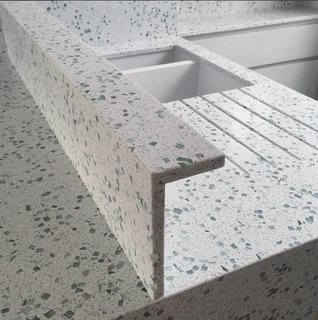 """The worktops are made by a British company called Resilica,"" says Baulier. ""They use glass waste (old windscreens, windows, and bottles) to create beautiful and incredibly durable countertops. Unlike terrazzo, it doesn't stain, as it is mainly glass bound with a solvent-free resin."""