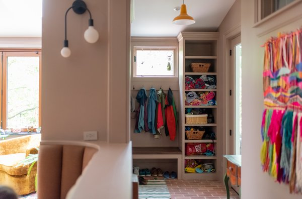 Now, the mudroom is just inside the door to the backyard and can stand up to Chicago winters with new brick floors  . It offers an excellent drop zone for coats, shoes, and even beach towels, as the house is just blocks from Lake Michigan.