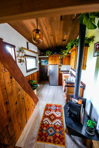 A glimpse down the aisle of the El Toro. The Hobbit wood stove from Salamander Stoves is a cozy accent.