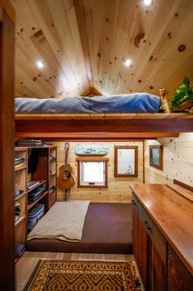 A sleeping loft perches over the living area in the Acorn.