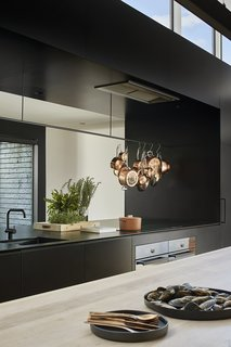 The kitchen faucet is the Vola KV1 mixer in black matte and the sink is the Abey SOHO Sink in black.
