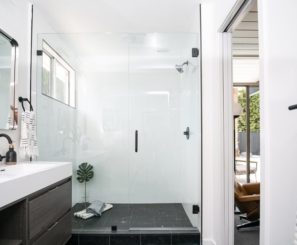 """The designers specified Nero Marquina tile in a 2""""x12"""" honed finish to cover the bathroom floor """"for a dramatic yet seamless look in the large master bathroom."""""""