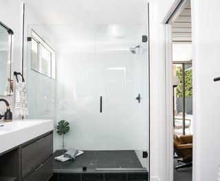 "The designers specified Nero Marquina tile in a 2""x12"" honed finish to cover the bathroom floor ""for a dramatic yet seamless look in the large master bathroom."""