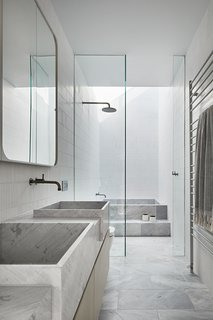 The soaking tub is fashioned from the same Elba Dolomite as the vanity for continuity.