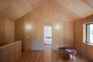 An unobtrusive door in the wall leads to an en-suite bedroom.