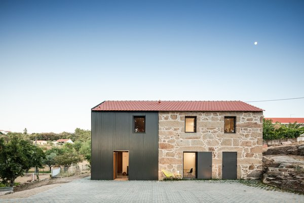 The firm added a 60-square-meter annex to the existing 88-square-meter stone building to fashion a residence that's now about 148 square meters (or around 1,500 square feet).