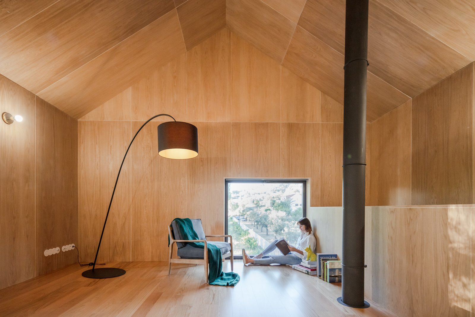 MCR2 House by Filipe Pina Arquitectura Wood clad walls