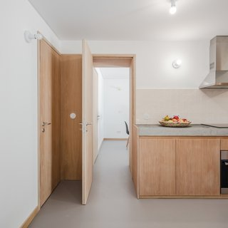 The door leads to an en-suite room that can be used for sleeping or set up as a dining room, as it is here.