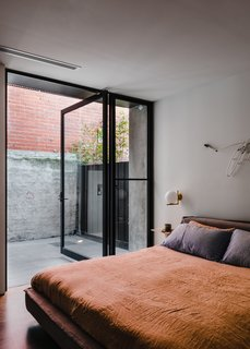 The master bedroom accesses a private, secluded courtyard.