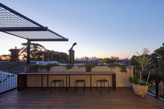 "A rooftop deck with spectacular city views was a late addition to the design. ""It was challenging to make the design for this work within the over-looking and over-shadowing requirements, but still maximize the outlook,"" says Bryant. ""We look forward to this space 'greening' up over time as the steel pergola covers with growing foliage."""