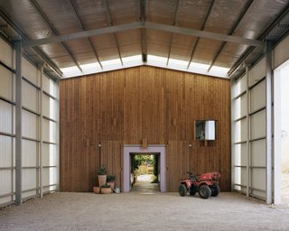 The entry leads into the garage, which separates the microclimate from the animal quarters. The farm has chickens, cows, pigs, ducks, and dogs to protect the premises from foxes and snakes.