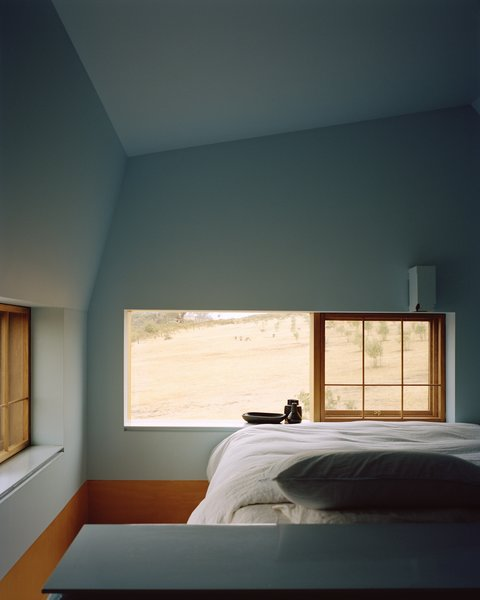 The cheery blue paint continues into the bedroom.