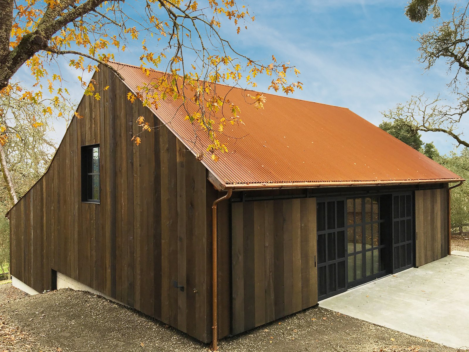 Tack Barn Reuse by Faulkner Architects sliding barn doors