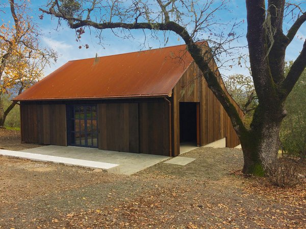After: The barn's original framing was kept for its agricultural character. Faulkner Architects applied an exterior envelope of salvaged redwood and added a Cor-Ten steel roof that will patina over time.