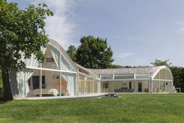 Best 60 Modern Exterior House Curved Roofline Design Photos