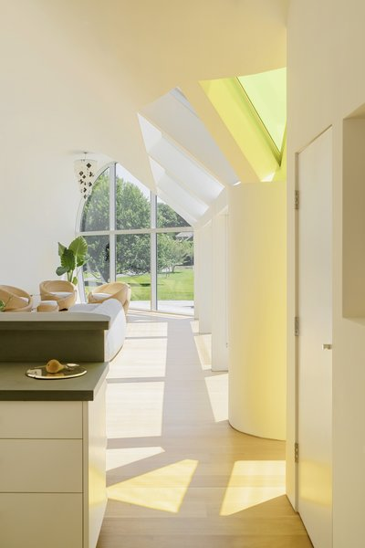 The bright yellow skylight was deliberately placed closest to the living spaces in the house, as the color signifies Venus and activity.