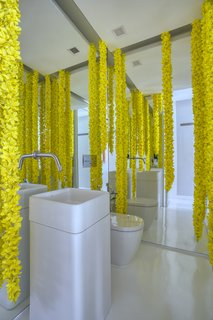 A powder room with whimsical flower garlands.