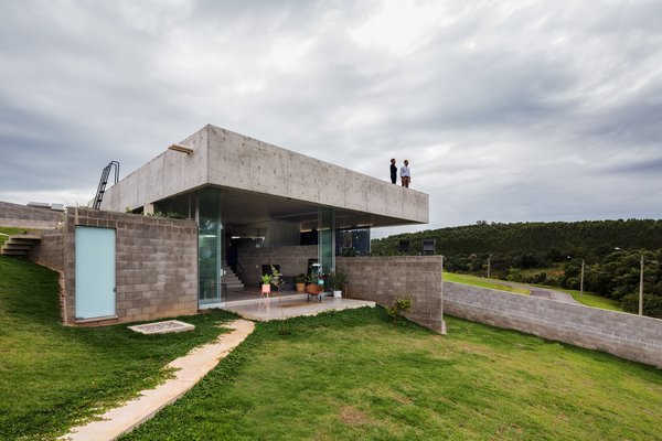 The firm worked to provide as much outdoor access as possible, so the living spaces spill out onto a protected veranda, and a ladder climbs up to the green roof.