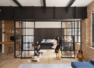 The firm used the steel to demarcate different areas. Glass-and-steel-framed walls now enclose the master bedroom, and an office nook with built-in storage is tucked off the primary circulation paths. The firm designed the custom bed platform; it's white oak with a smoked finish.