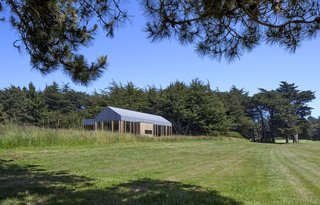 """We wanted to create a house that did justice to the incredible landscape of the Sea Ranch, and also to its immediate surroundings—a combination of bright open space looking toward the ocean, but also an area that was sheltered and shaded by a gorgeous stand of Cypress trees,"" say the couple. ""We also wanted to preserve and honor the tradition of Sea Ranch architecture—Kieron is a huge history buff, and he had started reading about the origins of the Sea Ranch build paradigm, as well as the utopian ideals upon which it was founded in the 1960s."""