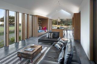 The open-plan living area has concrete floors and Douglas fir accents.