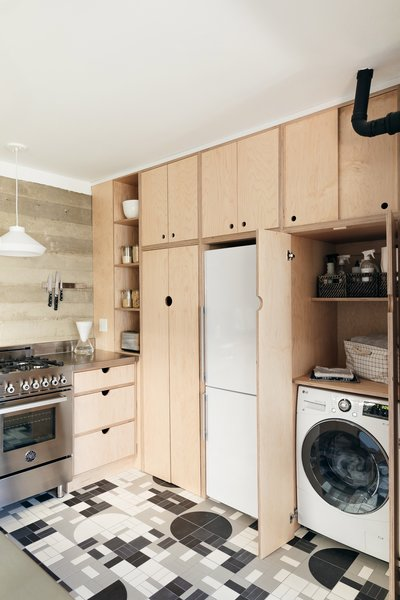 The wall of cabinetry conceals a washer/dryer unit as well.