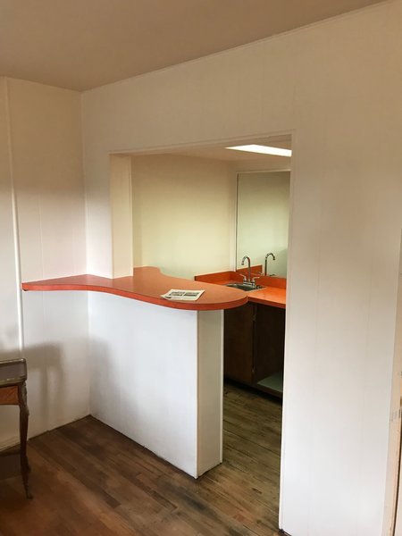 Before: There was an existing kitchenette in the basement that the couple removed, so they could relocate the kitchen against the concrete wall and expand its size.