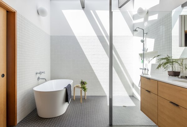 Now, a walk-in shower and soaking tub are tucked under the roof line.