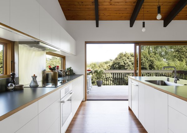 Streamlined, flat-front white cabinetry melds with white walls and doesn't detract from the views.