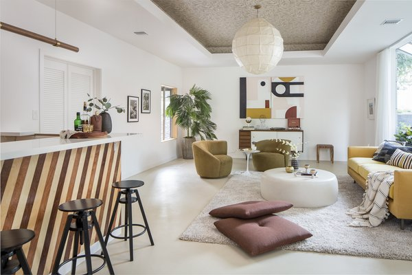 """The carpeting was removed to reveal the concrete slab underneath, which was finished with epoxy paint. """"That room just beckoned to be an entertainer's paradise,"""" says Wei."""