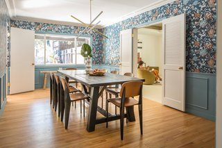 Wei kept the dining room's wallpaper, sprucing it up by combining it with hardwood floors and freshly painted wainscot.