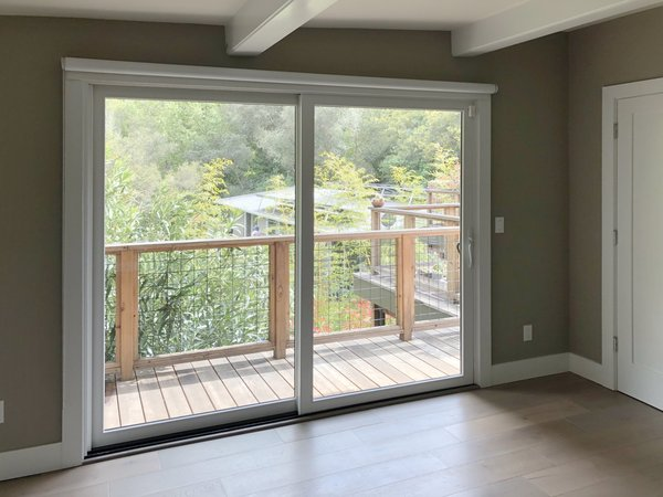 """Before: """"The thing with the rooms in the existing house was that the windows were small and they framed some views, but you really wanted…more of an inside-outside experience, especially with that deck being there,"""" says Duong."""