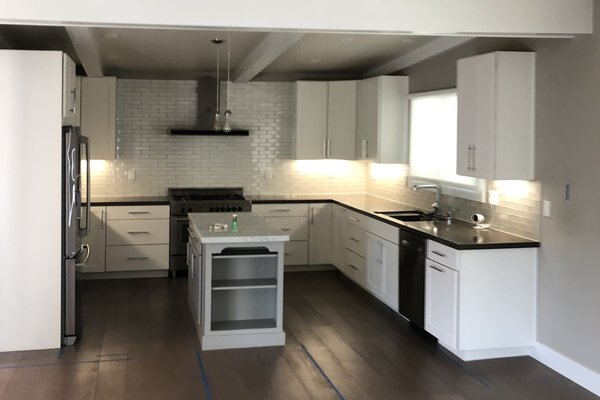 Before: The previous kitchen finishes skewed to a traditional aesthetic.