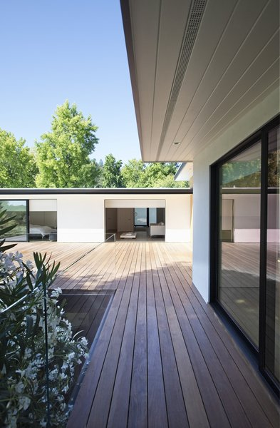 In addition to the wood screening, the house is finished in smooth-trowel stucco with black-framed openings to maintain the high contrast palette inside and out.