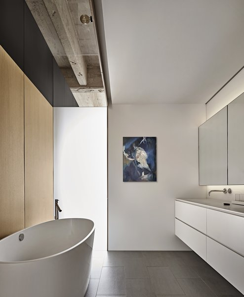 In the master bath, frosted glass borrows light from the main spaces and maintains privacy.