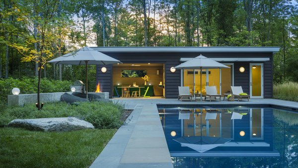 "The pool house was designed and built to mimic the main house, so they feel like ""a family of structures,"" says Porter."