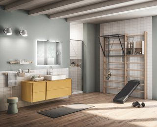 Blonde wood wall bars are complimented by bathroom fittings from Scavolini's Lagu line, including mustard yellow matte lacquered vanity units. The towel rail above the vanity sports a Gym Space storage shelf.