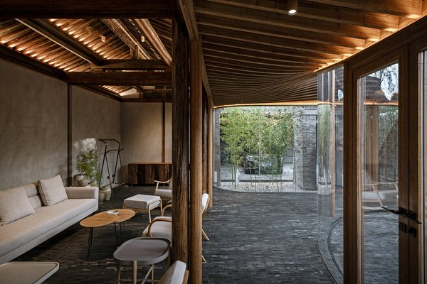 """The """"transparent veranda"""" allows natural light to penetrate the building's interior and connects the living areas to the exterior courtyards."""