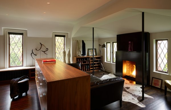 The architects removed two small closets (necessitating supports in their place) and added a new fireplace surround that mirrors those downstairs.