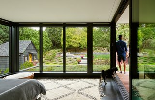 The glass-enclosed master bedroom with views to the backyard. A green roof helps to further merge inside and out.