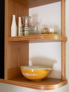 Exposed plywood shelving with a radial detail.