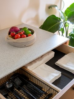 The counters are 12-millimeter solid surface, the LG High Max, sourced at Home Depot.