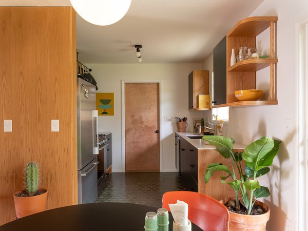 The kitchen's original galley layout was retained, and the walls and utilities were kept in place.