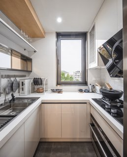 """The U-shape in the """"inside kitchen"""" allows the family to use the entire perimeter of the room for prep and storage."""