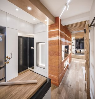 The designers wrapped the door in cabinetry to create more storage opportunities.