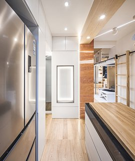 The recessed, padded bench also makes it so people can linger and talk to the cook.